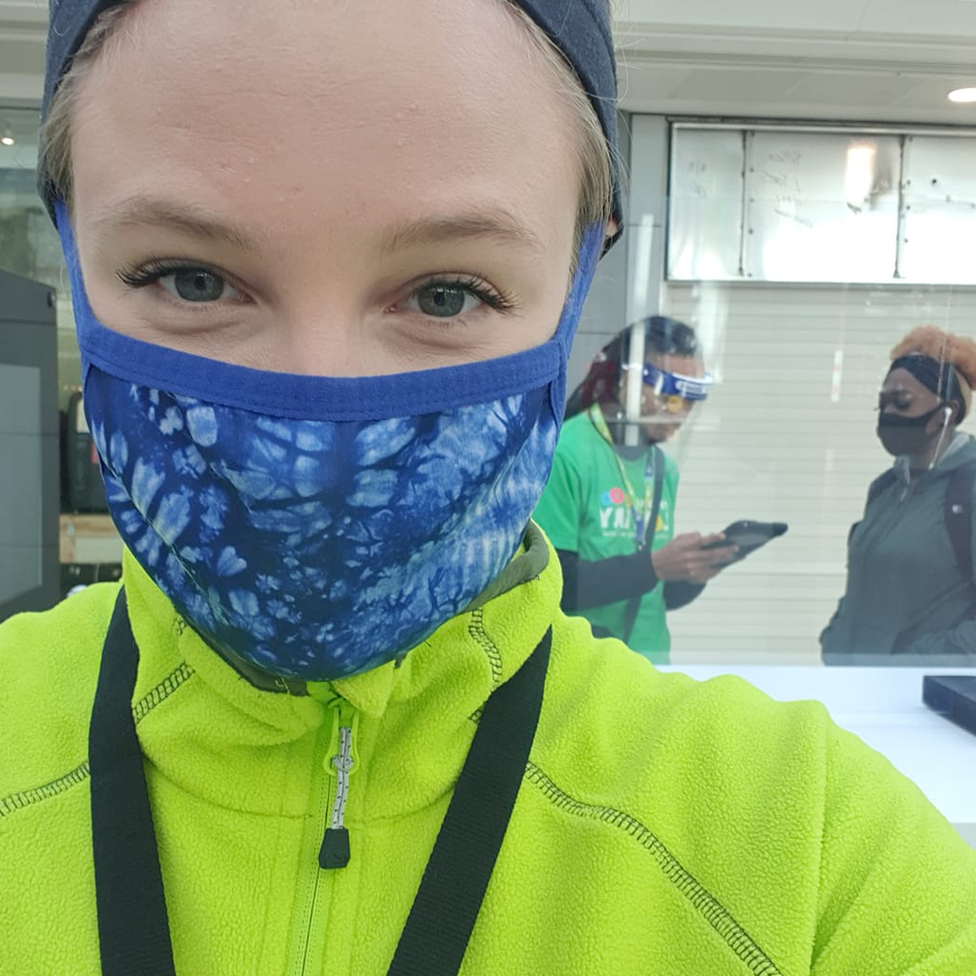 A fundraiser wears a face mask