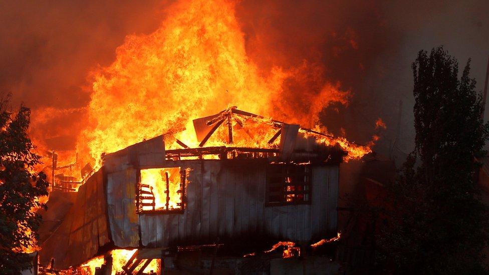Casa en llamas