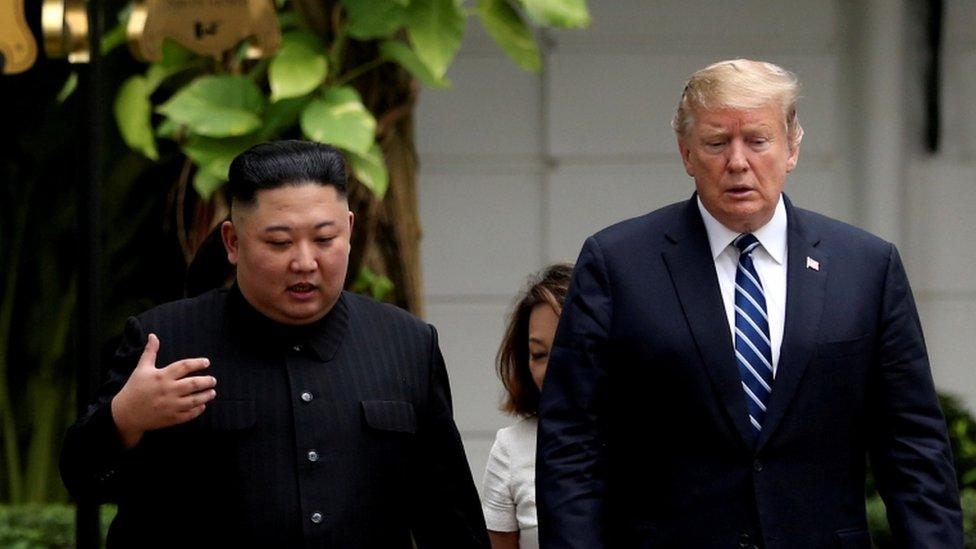 North Korea president Kim Jong-un and US president Donal Trump walking through the garden of the Metropole hotel during their summit on Feburary 28