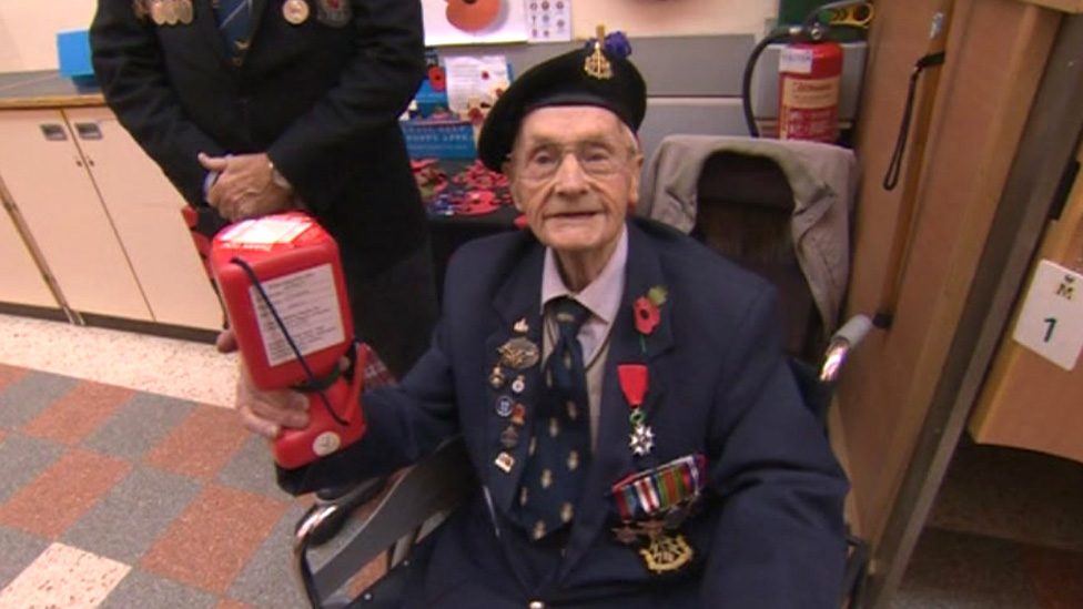 Britain's 'oldest' poppy seller dies aged 103