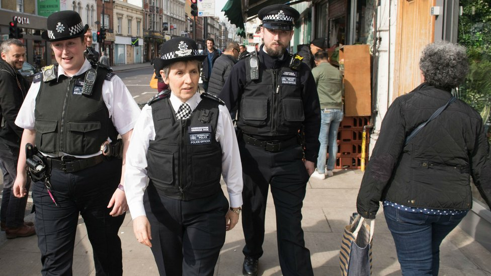 Metropolitan Police Commissioner Cressida Dick (centre) walks with officers through Stoke Newington in north London