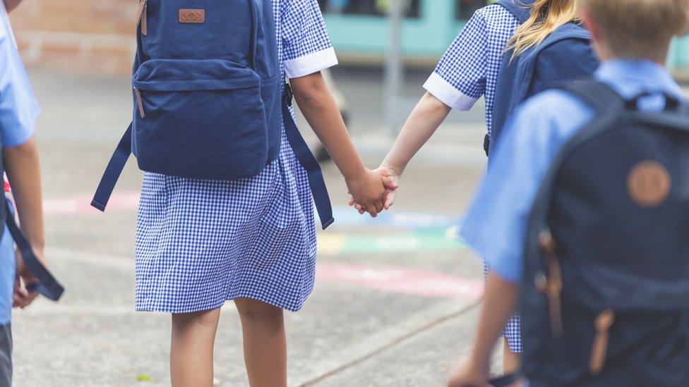 Third teenager held over hoax school bomb threats