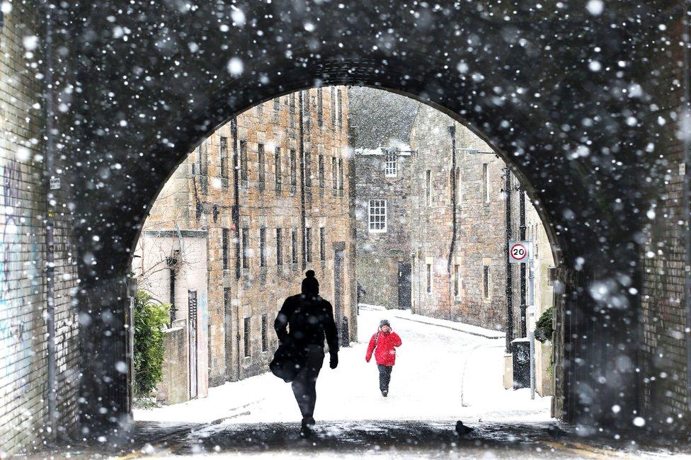 A view through the falling snow looking down the Croft-an-Righ in Holyrood, Edinburgh