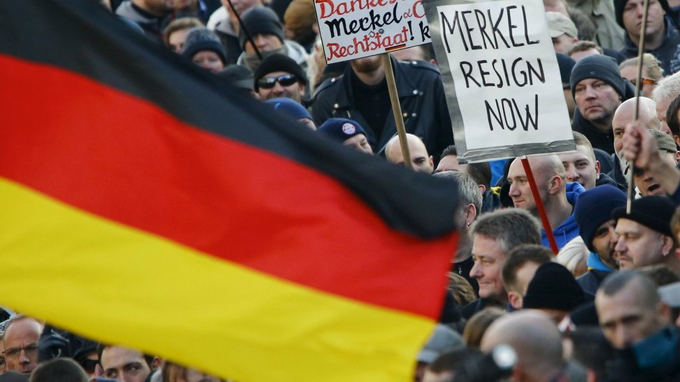 Supporters of anti-immigration right-wing movement Pegida in Cologne, Germany (9 January 2016)
