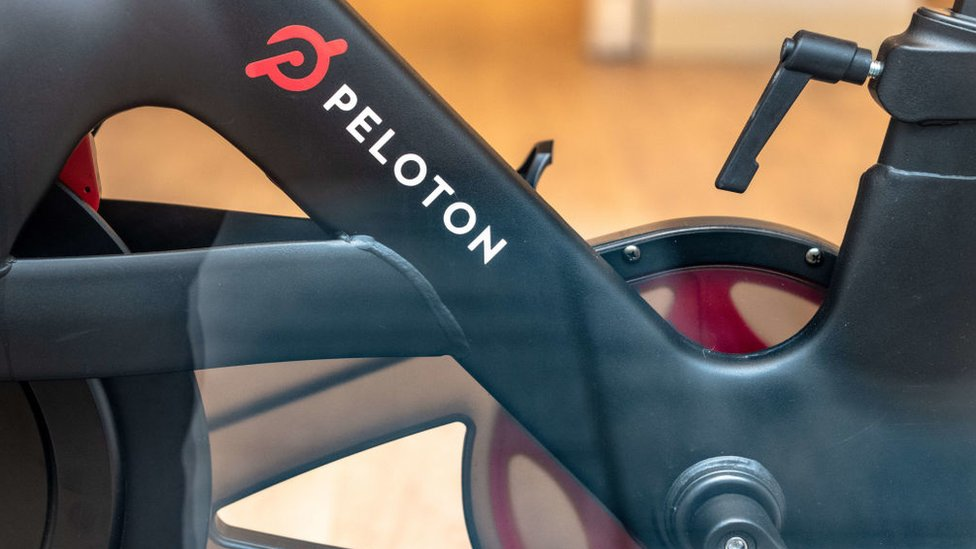 Peleton's logo is seen on the frame of its exercise bike in this photo