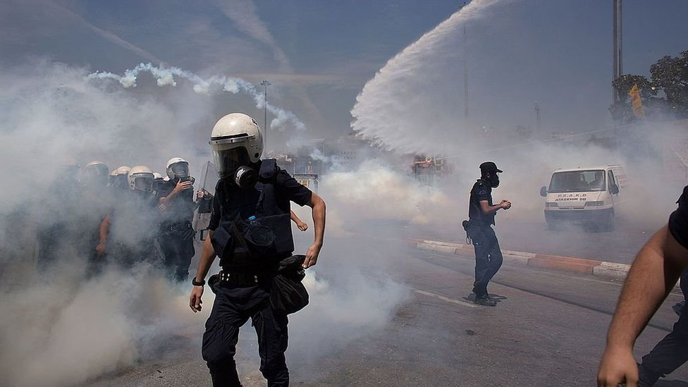 Riot police use water cannons and tear gas to disperse the crowd during a demonstration near Taksim Square n Istanbul, Turkey in 2013.
