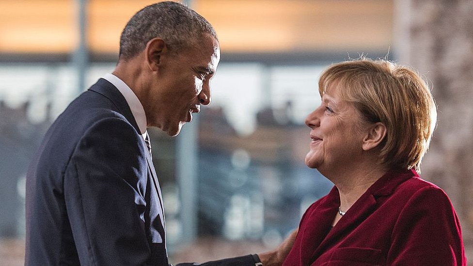 Barack Obama is greeted by German Chancellor Angela Merkel upon arrival at the chancellery on November 17, 2016 in Berlin