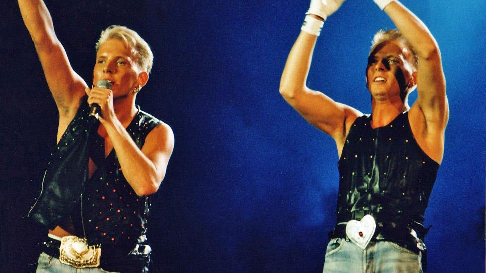 Matt and Luke Goss of Bros perform at Wembley Stadium in 1989