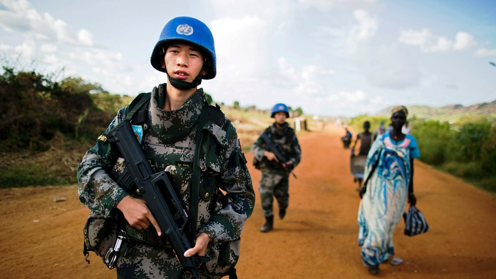 Chinese peacekeeping troops walk along a road in South Sudan