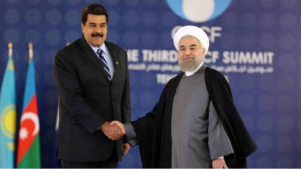 Venezuelan and Iranian leaders Nicolas Maduro and Hassan Rouhani shaking hands
