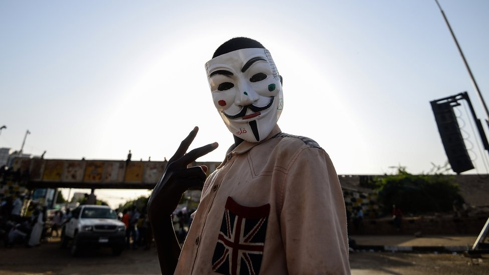 A Sudanese protester wears a Guy Fawkes mask outside the army headquarters in Khartoum on May 6, 2019.