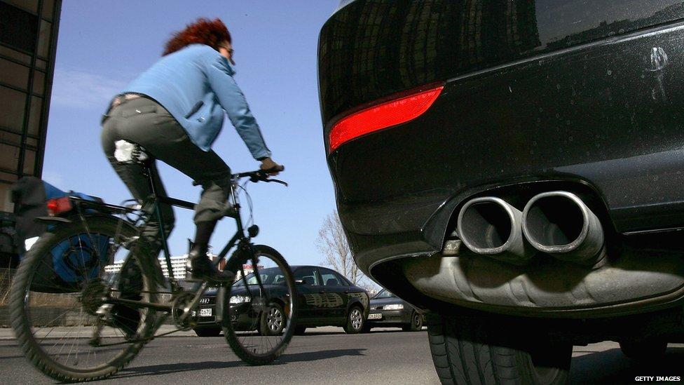 Cyclist passing car