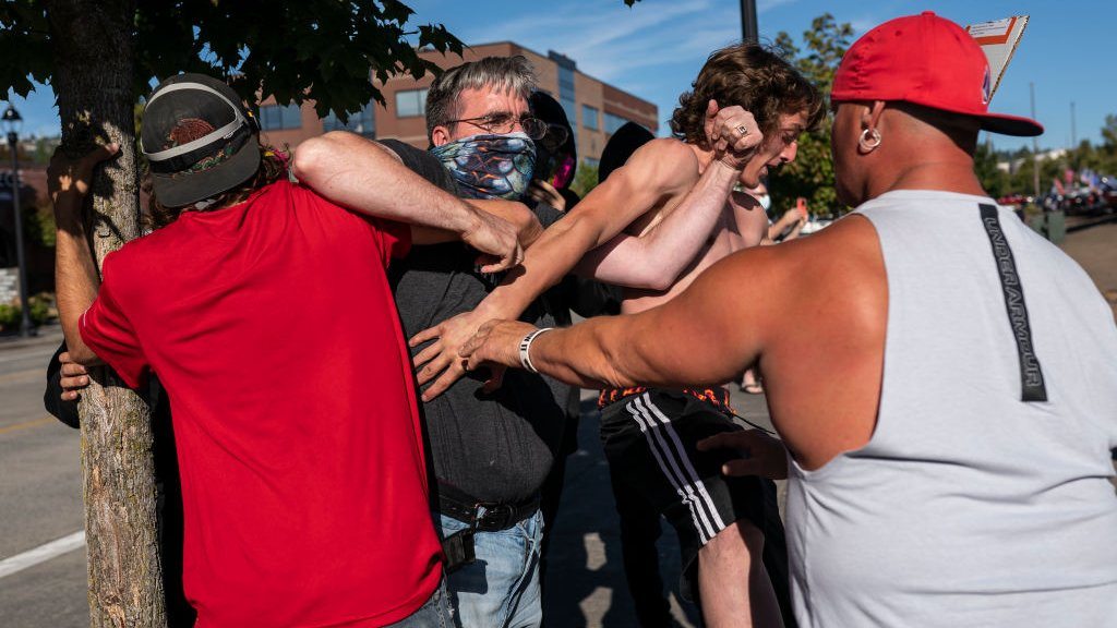 Black Lives Matter protester scuffles with Trump supporter in Portland, 29 August 2020