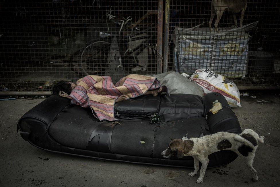 A girl sleeping on the side of the street in Parola Tondo Area, Manila City