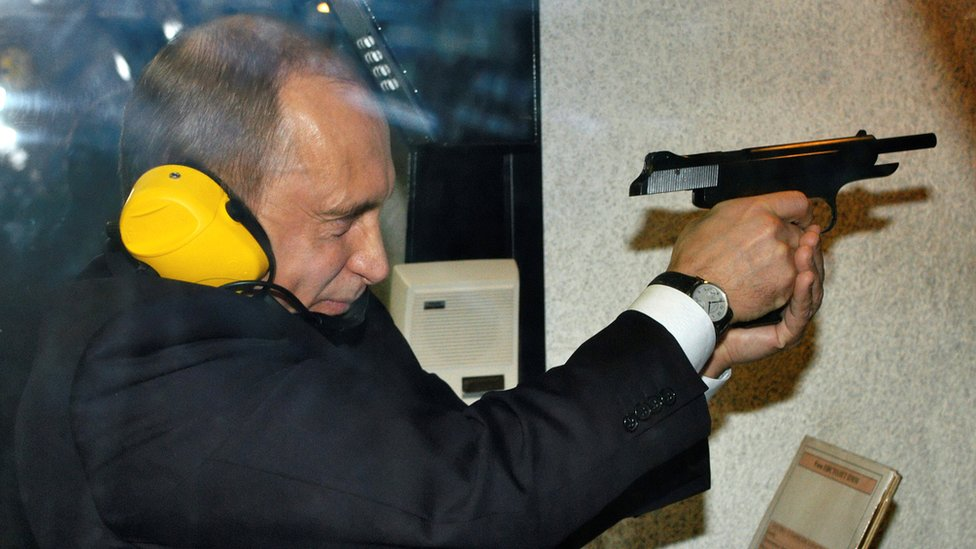 Vladimir Putin visits a shooting gallery of the new GRU military intelligence headquarters building in Moscow, 8 November 2006