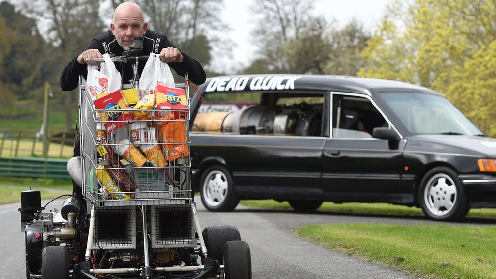 """Matt McKeown on board the World's fastest shopping trolley as he unveils his converted 1992 Ford Cardinal hearse """"Dead Quick"""" at the Prescott Hill Climb in Gloucestershire."""