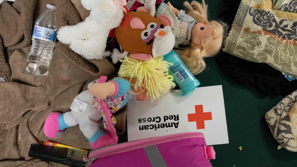Children's dolls and supplies lay on a cot at a Hurricane Florence evacuation shelter