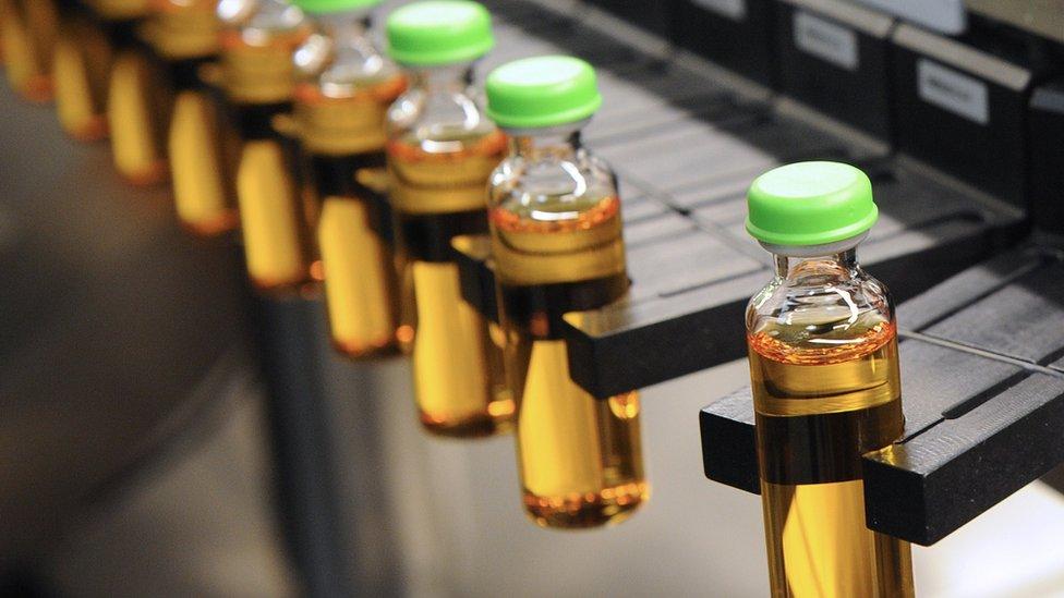 A line of insulin vials at a manufacturing factory