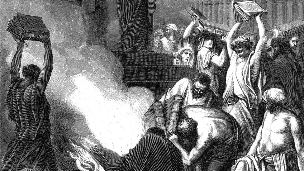 Pagan books are burned at Ephesus. Acts 19 illustration was published in 'bible or books of new testament and old testament'(1875)