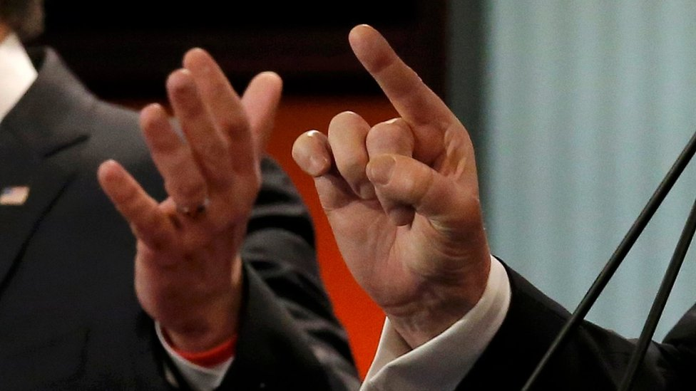 Marco Rubio and Donald Trump gesture during debate