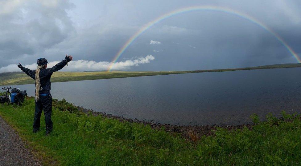Paul looks at a rainbow