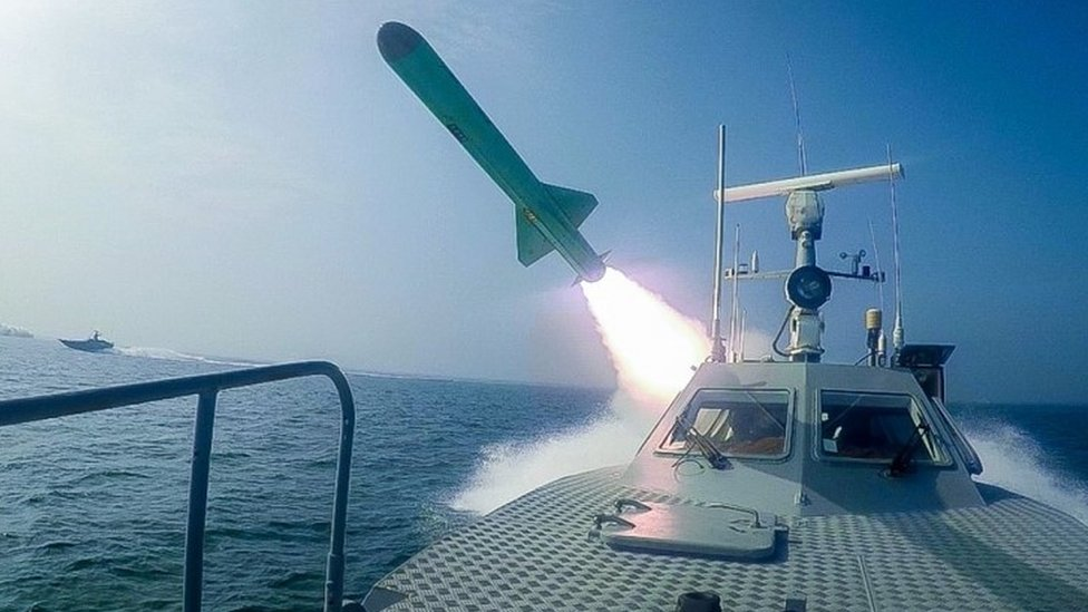 The Iranian military fires a missile targeting the replica
