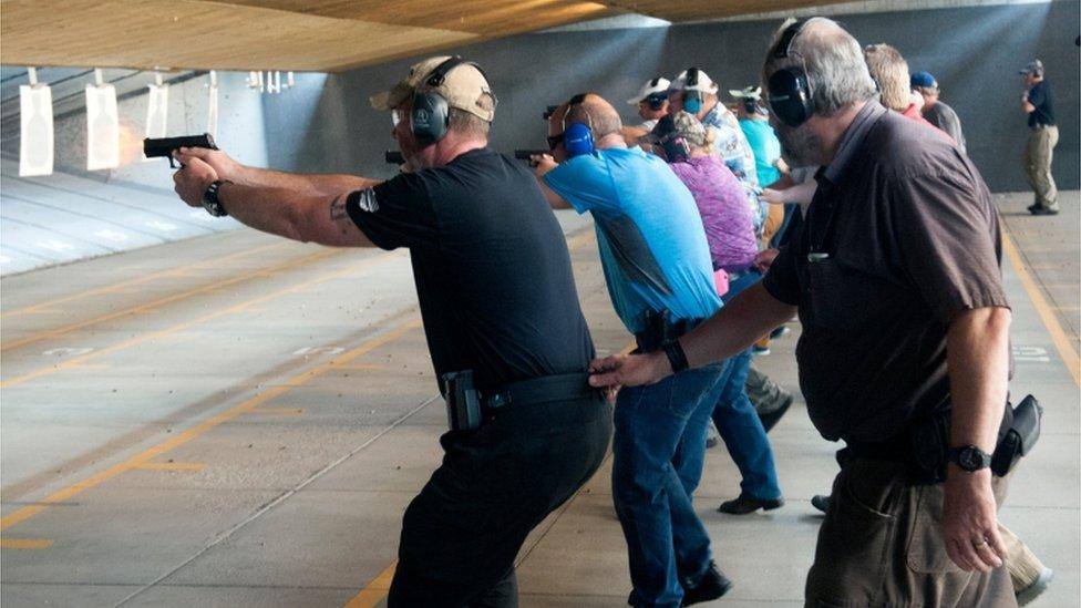 School staff firing guns