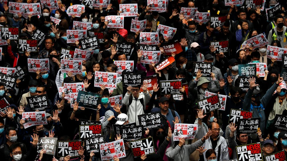 """Anti-government protesters attend a demonstration on New Year""""s Day to call for better governance and democratic reforms in Hong Kong, China, January 1, 2020."""