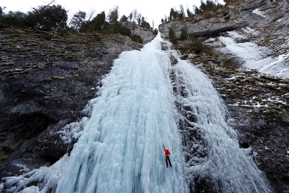 Italian alpine rescuers climb a frozen waterfall in Malga Ciapela, Italy, 11 February 2020