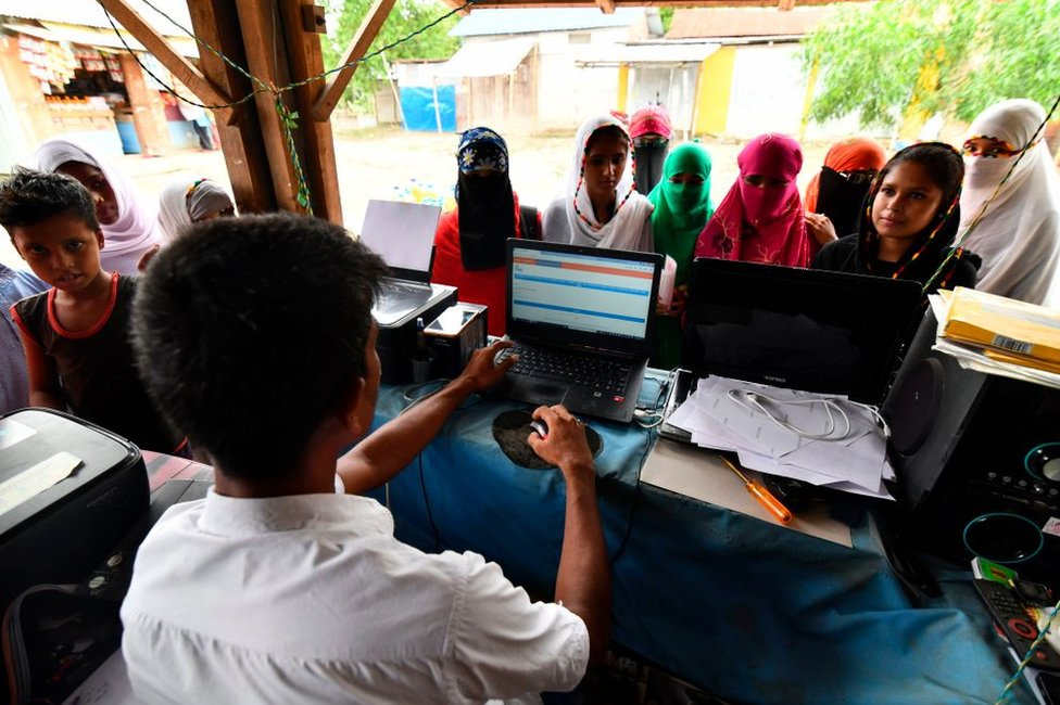 Muslim women check their names on the final list of the NRC in Assam 31 August 2019