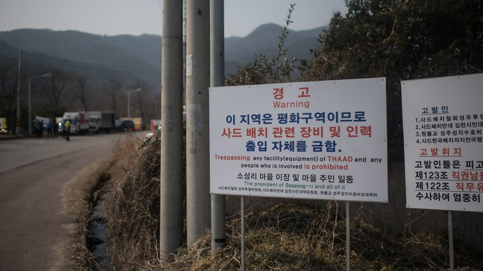 A sign is displayed outside a golf course being used as the site for the recently installed US Terminal High Altitude Area Defense (THAAD) system, in Seongju on March 18, 2017.