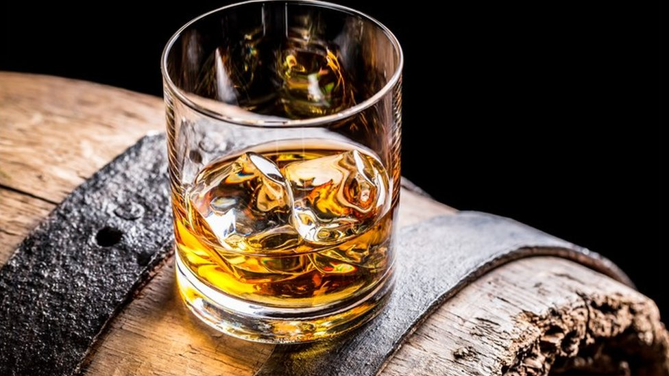 whisky glass on barrel