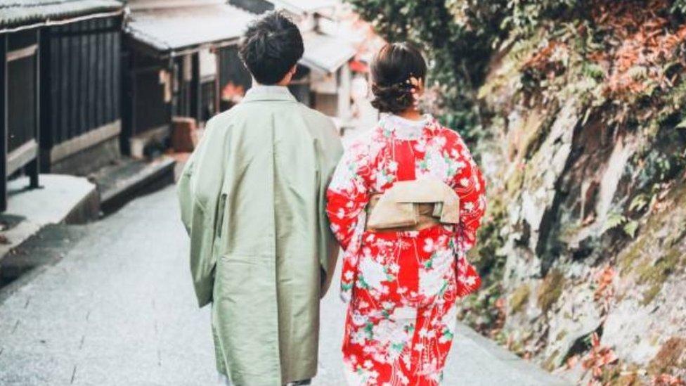 A couple walking in Japan