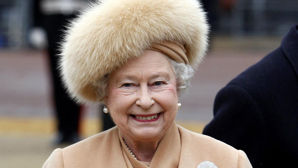 Queen Elizabeth II in a fur coat, as she no longer uses fur in her outfits, having switched to fake fur this year, her senior dresser has revealed