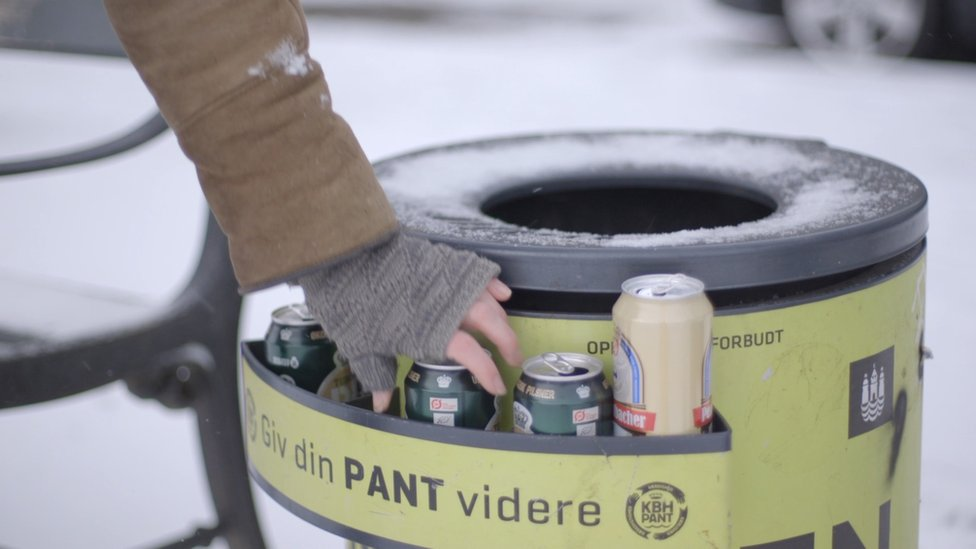 Bin shelf with person picking out can