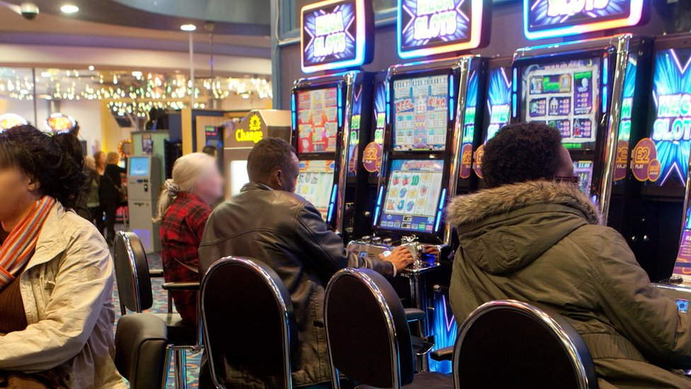 People playing on the gambling machines