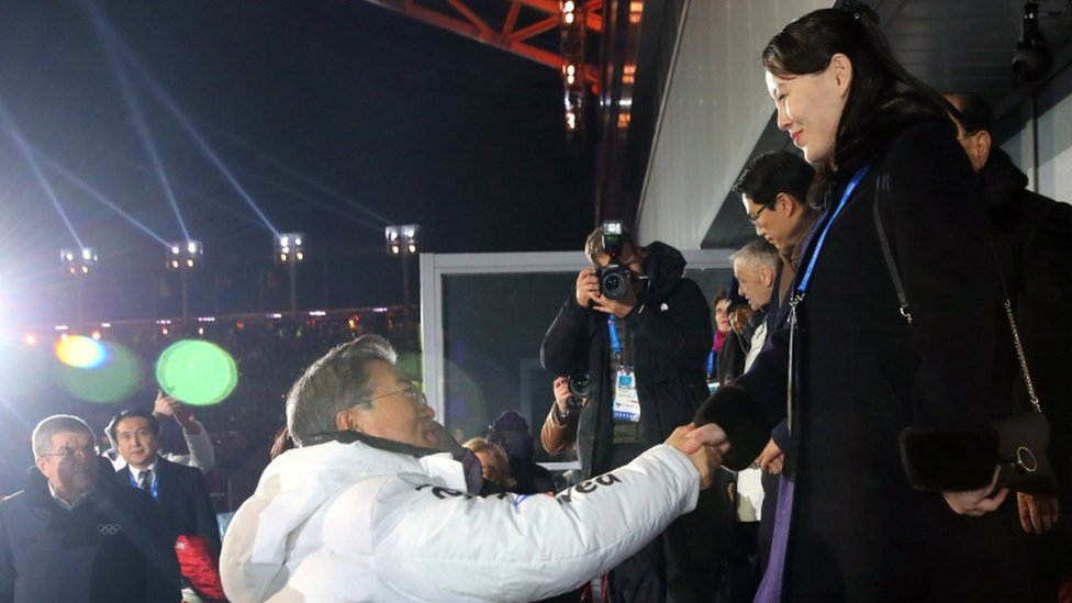 """Kim Yo Jong (R, the sister of the North Korean leader) shakes hand with South Korea""""s President Moon Jae-in during the opening ceremony of the Pyeongchang 2018 Winter Olympic Games at the Pyeongchang Stadium on February 9, 2018."""