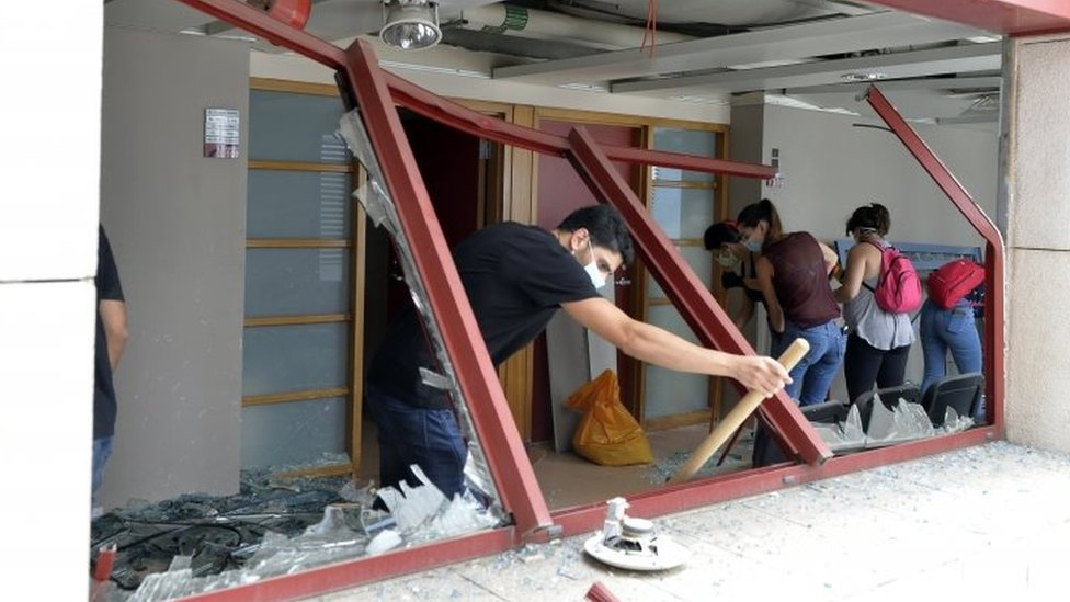 Lebanese young people clear glass debris at the Al-Roum hospital in the aftermath of a massive explosion at Ashrafieh area in Beirut, Lebanon, 6 August 2020