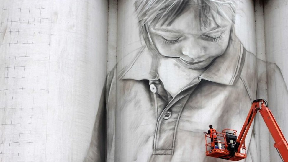 A portrait of a local schoolgirl painted on the side of a grain silo in Coonalpyn, South Australia