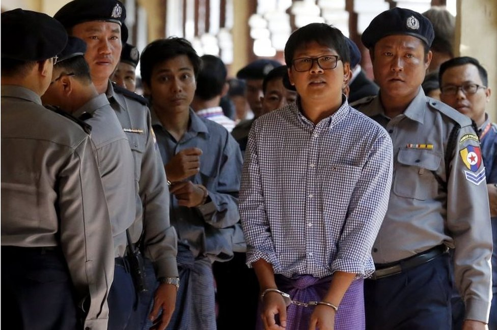 Detained Reuters journalist Wa Lone (2-R) and Kyaw Soe Oo (2-L) are escorted by police as they leave the court after the hearing in Yangon, Myanmar, 01 February 2018.