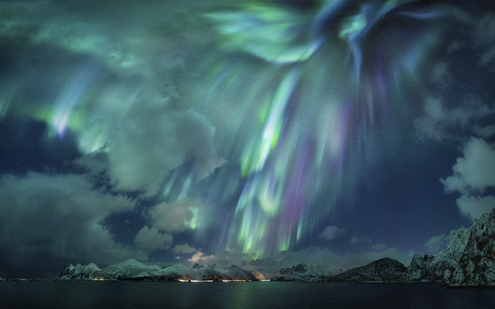 An image of night sky in Norway with bright aurorae