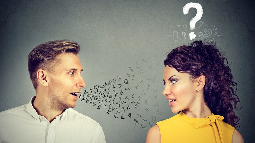 Concept image: a man is talking to a woman (there are letters coming out from his mouth) but she doesn't understand him (she's got a question mark over her head)