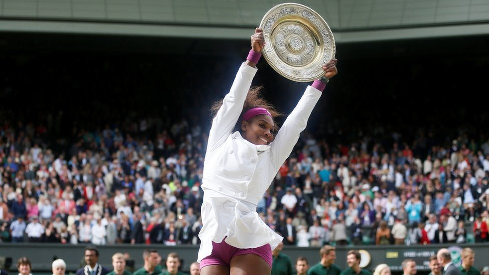 Serena Williams of the U.S. holds her trophy after winning the Wimbledon tennis championships in London in 2012.