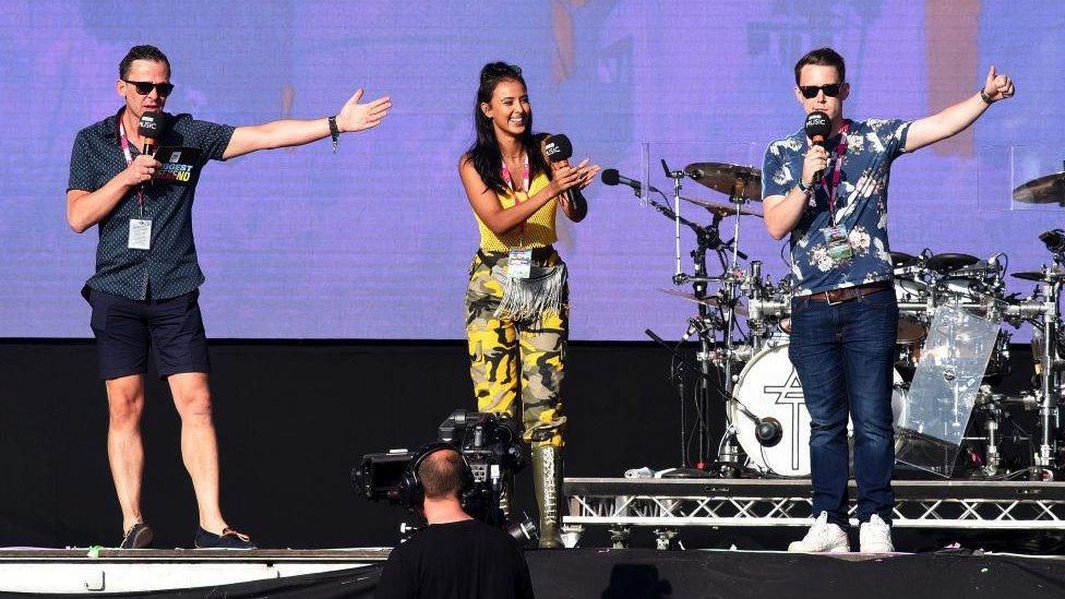 Scott Mills, Maya Jama and Chris Stark on stage at Radio 1's Big Weekend