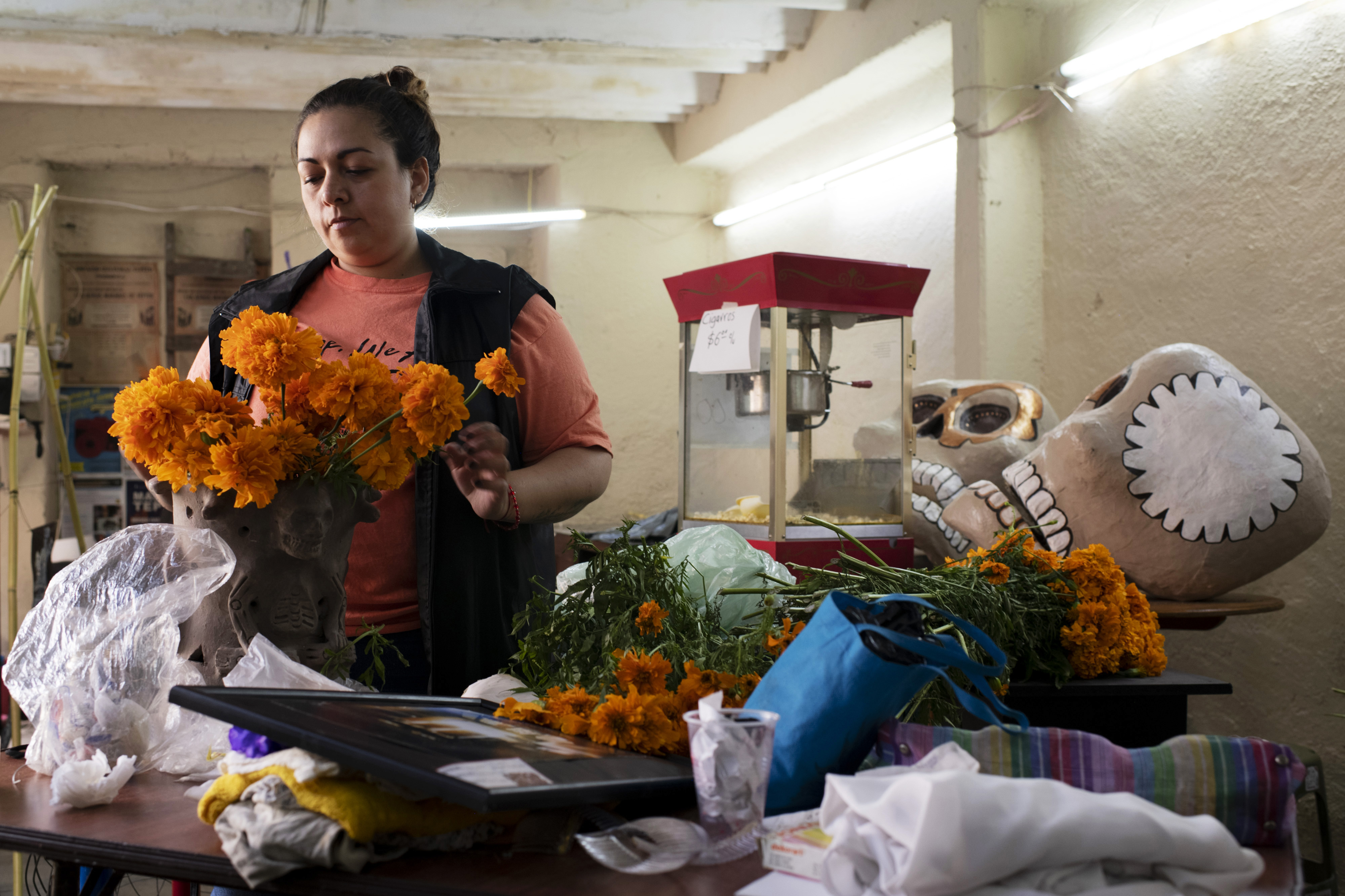 Malinali Garcia, who is part of the Tepito cultural space, is making preparations to put on the traditional offering for the Day of the Dead