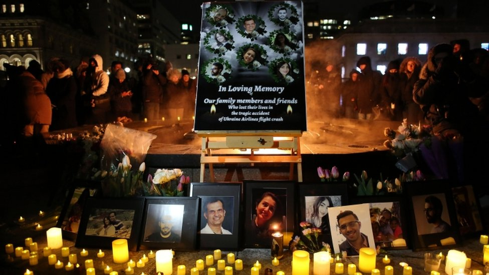 An altar with photographs of the victims who were killed in a plane crash in Iran is seen as people gather around to held a vigil in their memories on January 09, 2020 in Ottawa, Canada