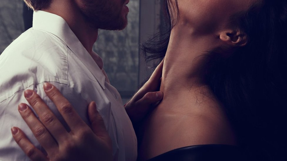 Man touching partner's neck