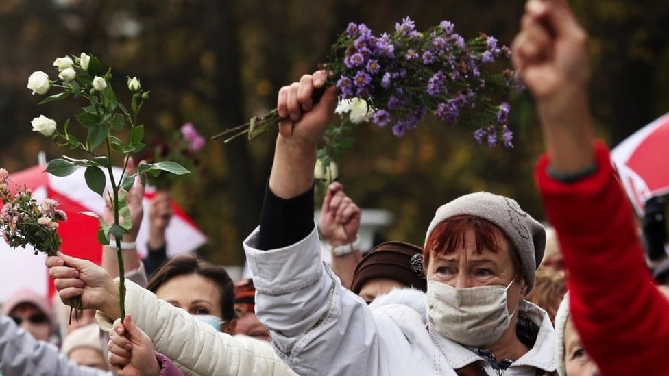 Belarusian women demand free and fair elections during a protests in October 2019