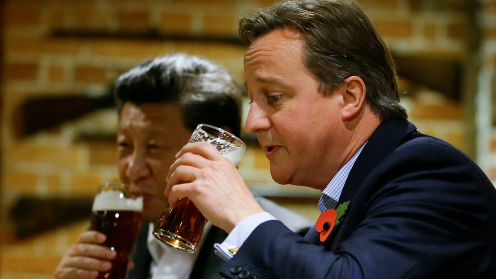 David Cameron drinks a pint of beer with Chinese President Xi Jinping, at a pub in Princess Risborough near Chequers