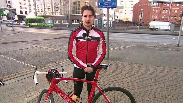 Cyclist outside BBC Nottingham